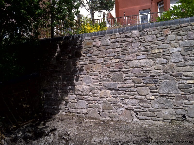 whether its using existing materials to rebuild or repair or acquiring new stone grow landscaping can use our style to produce stunning boundary walls